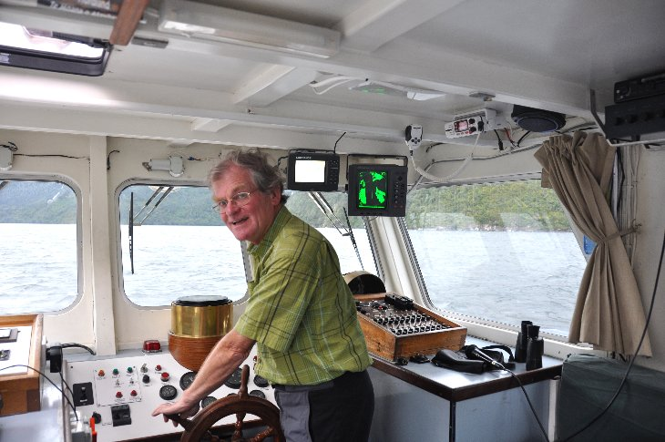 At the helm on the Doubtful Sound