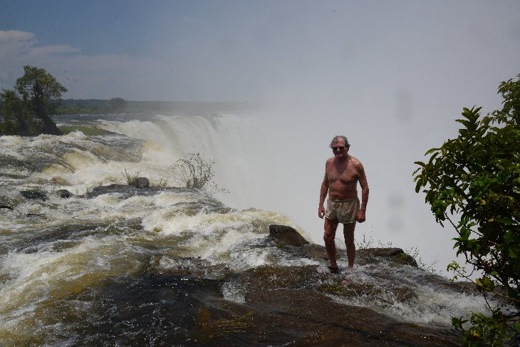 Standing on the edge of the Victoria Falls
