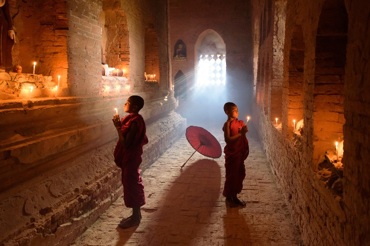 two young novice monks at their devotions