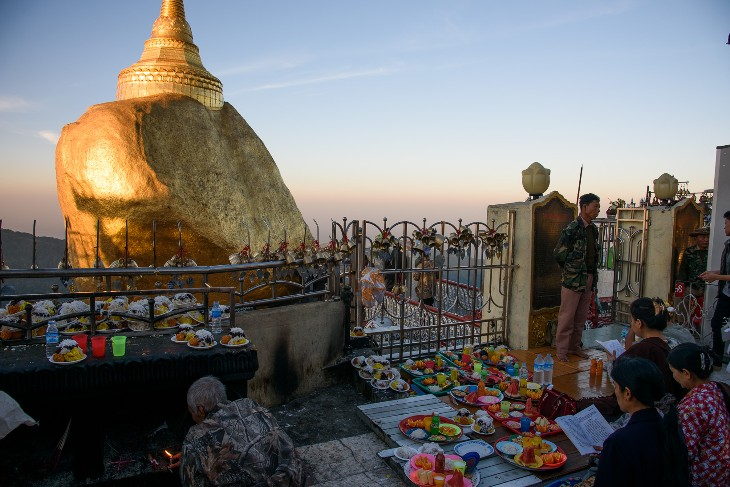 offerings made at dawn before the Golden Rock